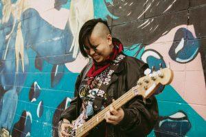 Lilah Davis playing bass