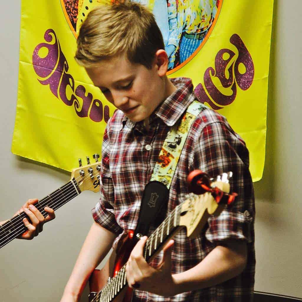 Wren taking guitar lessons in Edmonton