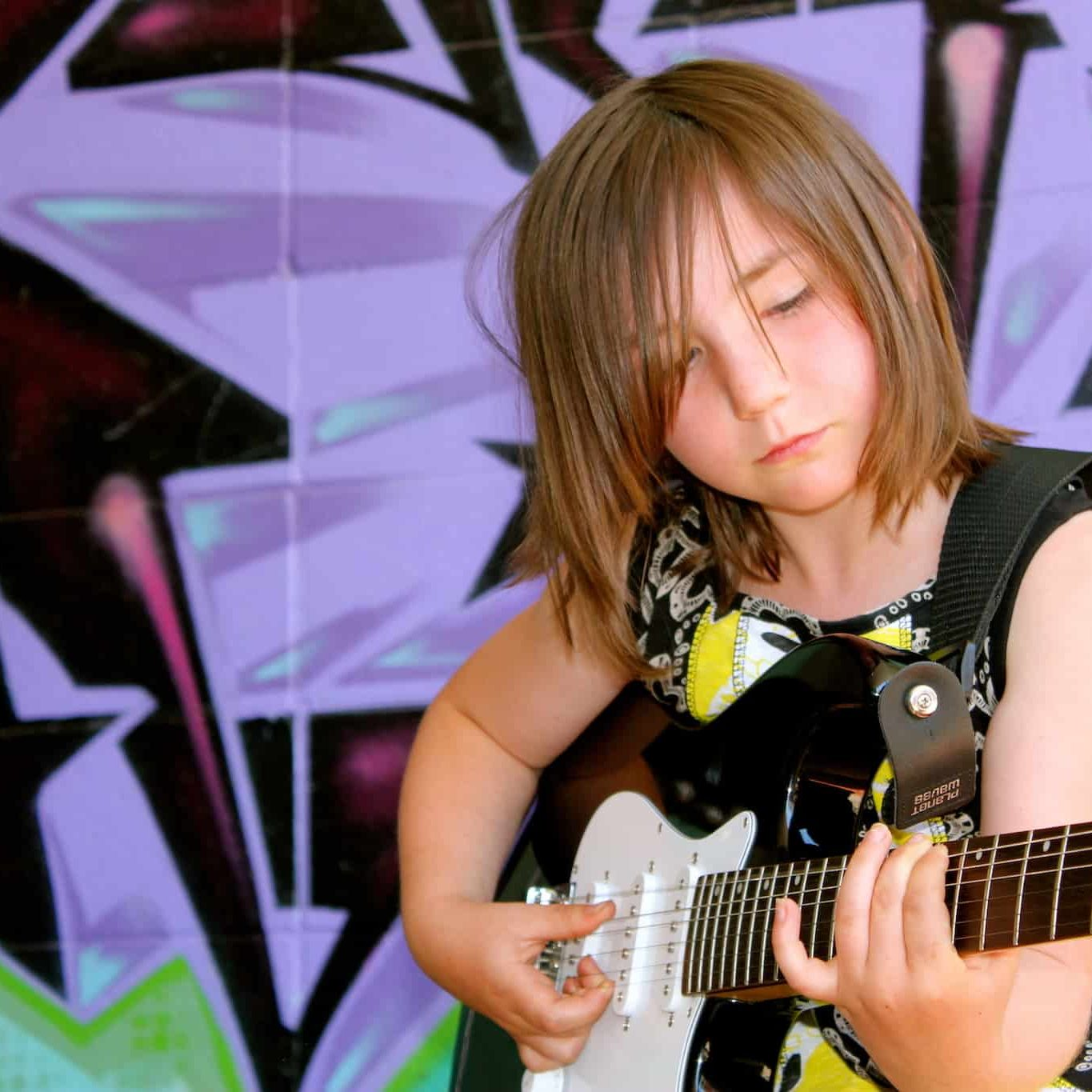 Mallory taking guitar lessons in Edmonton